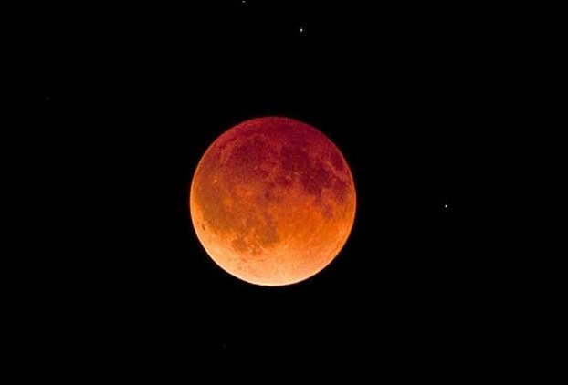 In the total lunar eclipse the moon will be more bigger , brighter and red in colour