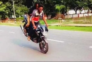 A Stunt biker performing a dangerous act in the University Campus
